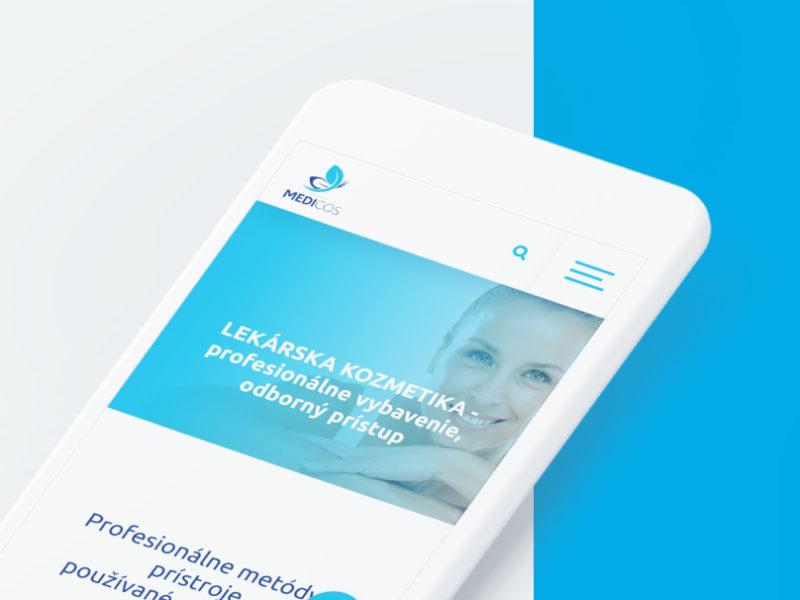Záber na mockup s bielym mobilným telefónom, na ktorom je zobrazená mobilná verzia webu www.medicos.sk