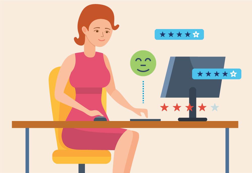 Žena sedí pri počítači, ktorá píše pozitívne odporúčanie